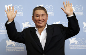 "Japanese director Kitano poses during the photocall of the movie ""Outrage Beyond"" at the 69th Venice Film Festival"
